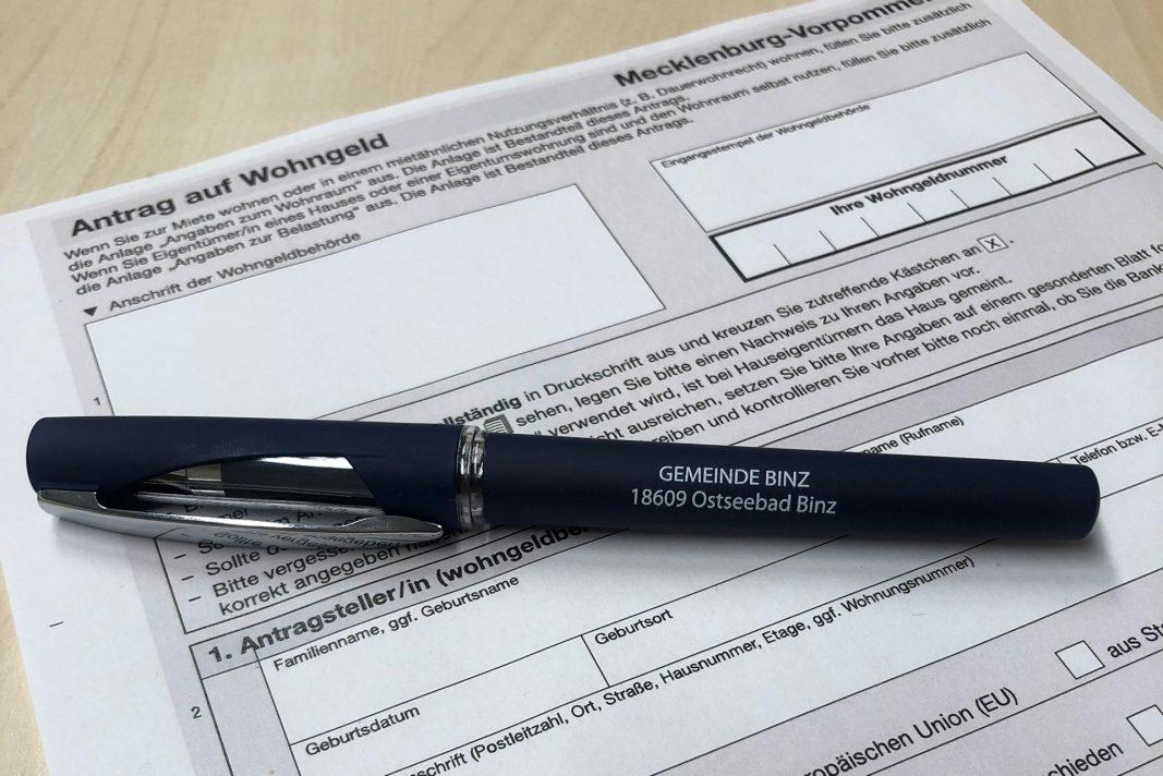 Ein Antrag auf Wohngeld mit einem Stift.